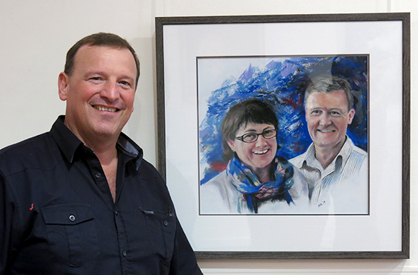 Mal Barnes with his portrait of Dr Duncan and Sue McKinnon